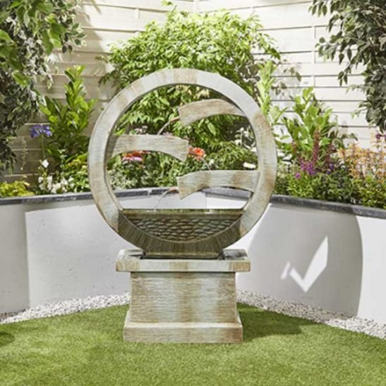 Our Tranquil Spills water fountain will create a calm and tranquil area with this stunning outdoor water feature. Simply plug in, add water and watch as the water trickles and circulates around. Dimensions: H1350mm x W950mm x D390mm Barcode: 5055066420953 Use fountain cover size: MEDIUM
